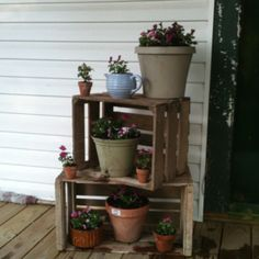 Old wooden crates used as flower stand!!