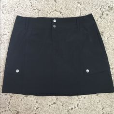 TekGear sports skirt NWOT black skirt.  Skirt is a smooth poly/spandex blend with a bit of stretch, shorts are same blend but more stretchy.  Two snap pockets on the sides. Tek Gear Skirts