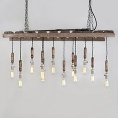 Awesome pallet light fixture pallet crates, old pallets, pallet wood, palle Diy Wood Pallet, Pallet Crates, Old Pallets, Chandeliers, Chandelier Lighting, Rustic Chandelier, Pallet Light, Pallet Side Table, Do It Yourself Baby