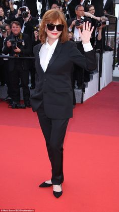 Waving to the fans: The Thelma & Louise star oozed class in her stylish black suit worn ov...