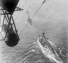 British battleships steaming out to meet the High Seas Fleet arriving in for internment, November 1918 - HMS Queen Elizabeth in the foreground.