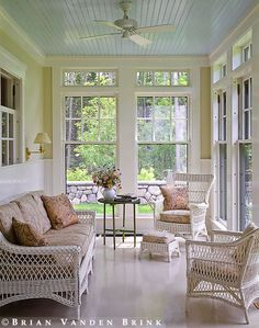 I like the classic blue painted ceiling on the sun porch.