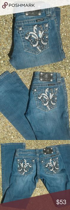 Miss Me Fleur De Lis Jeans 27 X 32 Gorgeous Miss Me jeans!! Black and white fleur de lis pocket design and rich deep, dark blue wash. Perfect condition, all rhinestones/rivets in tact, minus 2 small tears  about an inch from bottom as seen in last picture. No fraying or damage to ends from being walked on. Absolutely beautiful in person! Miss Me Jeans Boot Cut