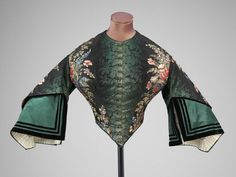 Bodice of silk trimmed with velvet, lined with silk, boned, linen tape. Made in France, ca. 1865.