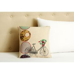 This throw pillow from Cottage Home will complement any room's decor. A unique bicycle motif adorns this appliqued cotton pillow.