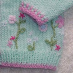 Mint Blush Beautiful baby cardigan with embroidered flower detail, hand knit using soft mint baby yarn and a warm pink contrast. Ideal for baby girls aged 0-3 months. Mint Blush is both machine wash and dryable for convenience, ideal for the busy new Mamma. Each cardigan will differ slightly in terms of embroidery detail for a truly unique gift. Chest: 18 / 46cm Length: 9 / 23cm Arm: 6 / 15cm Lovingly handcrafted in a smoke and pet free home. Thanks for your interest Shop Hom...