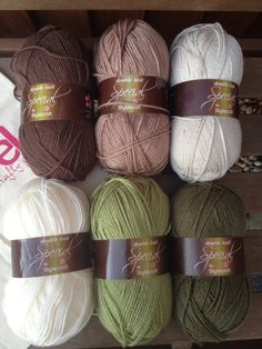 This is a complete kit to make a crochet granny stripe blanket like the one pictured in beautiful shades of brown, cream and green. Whats included in