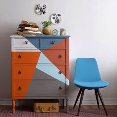 """Poppyseed Creative Living says, """"I opted for a bold combination blues and oranges from the Chalk Paint® line by Annie Sloan. Colours are Barcelona Orange, French Linen, Pure White and custom mixes of Barcelona Orange and Scandinavian Pink, Paris Grey and Aubusson Blue and Pure White and Louis Blue. This dresser was built in the first half of the 20th century and with its new look it can proudly represent the new millennium."""""""