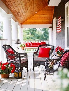 Red geraniums, red pillows, wicker furniture, American Flag, porch swing...it's speaking to me :)