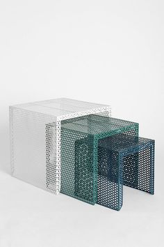 Super modern, I know, but so interesting I couldn't resist sharing. Nested Caged Metal Side Table