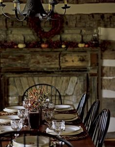 like the wood lining of fireplace. and winter decorations. as well as fireplace in dining area.