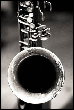 Great angled image direct into the saxophone. The black and white image shows the intricate shadows and scratches that makes it very antique.