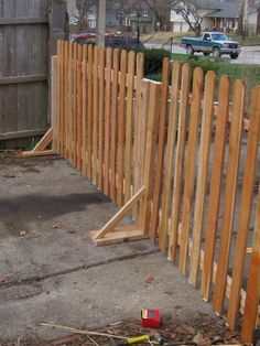 free standing fence, covering the driveway entrance to the backyard