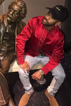 Big Sean wearing  Saint Laurent London Ankle Boot, Acne Bomber Jacket, Off-White c/o Virgil Abloh x Levi's Jeans