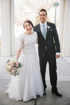 Sleeve lace wedding dress with boat neck groom in navy blue suit