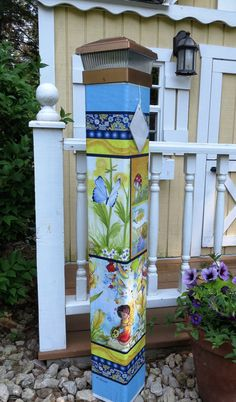 """Our stunning Fairy Garden- Garden peace 41"""" pole features fairies at play. The whimsical design and bright colors will add a bit of unique magic to your landscape, lawn, or garden. A beautiful solar light crown for the pole is included with your purchase"""