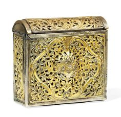 A FINE PARCEL-GILT SILVER CARTRIDGE CASE  OTTOMAN TURKEY OR GREECE, LATE 18TH CENTURY  Of rectangular form with rounded cover, the front, top and small sides with applied openwork panels with dense foliage, the central panel with raised centre, the back with engraved belt loop