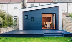 A striking extension finished in black timber cladding, designed by PLANSTUDIO (hello@planstudio.uk). Lewisham, London