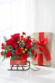 Teleflora's Vintage Sleigh Bouquet | Christmas Flowers | Holiday Bouquet | Christmas Gift | Christmas Decor | #Teleflora #Christmas Christmas Centerpieces, Holiday Decorations, Table Decorations, Christmas Villages, Christmas Gifts, Christmas Flowers, Local Florist, Decor Crafts, Flower Arrangements