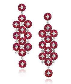 Cellini Jewelers Ruby and Diamond Drop Earrings  Marquise-shape rubies, in clusters of 4, form circles with a round brilliant-cut diamond at each center.