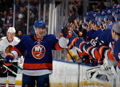 Casey Cizikas Photos - Casey Cizikas #53 of the New York Islanders celebrates his goal at 15:24 of the first period against the Chicago Blackhawks at the Nassau Veterans Memorial Coliseum on January 2, 2014 in Uniondale, New York. - Chicago Blackhawks v New York Islanders