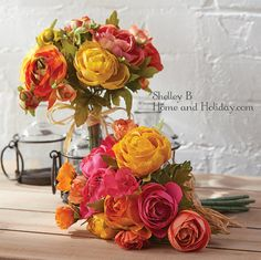 Ranunculus artificial flower bouquets.  Add to a vase or container for a quick decorating idea that add colors to your decor.  Shelley B Home and Holiday.com Shop Home Decor: Floral Decor category.