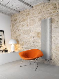 Runtal RX wall-mounted radiator | flat, oval, powder-coated tubes 8mm wide. 52 colors and 12 spacing choices between elements available. wish we could use this but we need something electric.