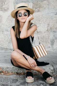 Black mini with black espadrilles, hat, sunnies, and a great chain and stripes shoulder bag.