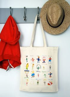 Kids' self portraits on canvas bag as teacher gift.