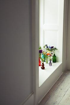 London Victorian House, Colored Vases with Flowers