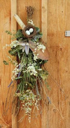 Love this nature/garden inspired swag idea. A birds nest with eggs, old rusty garden trowel and dried floral and greenery. The hardest part would be wiring it all together to keep gravity from taking its' toll.