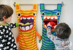 Hungry Monster Laundry Bags Ever wonder where those socks go? Well the hungry monster laundry bag eats them! Try this fun DIY craft, make a kid a laundry bag so they always keep tidy and clean. (Diy Gifts For Kids) 40 Diy Gifts, Diy Gifts For Kids, Diy For Kids, Crafts For Kids, Gift Bag Storage, Kids Room Accessories, Fun Diy Crafts, Sewing Projects For Beginners, Diy Projects