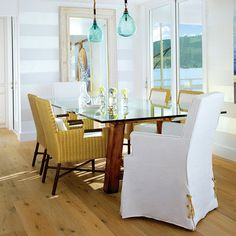 Show your stripes. White walls are warmed up with wide bands of pearly gray in the subdued dining room of this 1960s cottage in Belvedere, California.