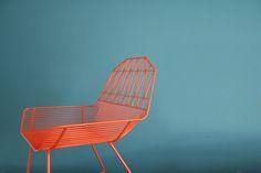 orange wire chair