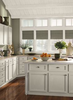 B.M. November Rain on these cabinets for the wall color in the living room.  Cloud White is the color on the ceiling and trim.