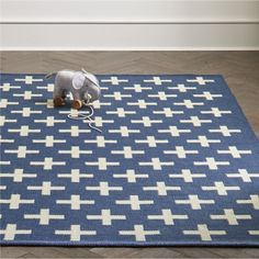 Shop Positive Blue Indoor Outdoor Rug.  What are the pluses and minuses of this rug? Well, it features a bold, design, so that's a plus.  It can also be used anywhere from the playroom to the patio, so that's a bigger plus.