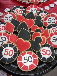 Ok I think these would be pretty awesome to have on tables around the casino area... cookies shaped as casino chips and card designs... or we could even have servers walking around with trays of them just passing them out
