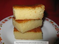 Tapioca cake. BATTER: 2 cups cassava (Tapioca) flour, 1 cup sugar, 1/2 cup evap milk, 1/2 cup coconut milk, 1 cup young coconut (optional, 2 eggs (yolk and white beaten separately), 2 tsp baking powder, 1/2 cup butter, 1/2 tsp vanilla. TOPPING: 3 egg yolks, 1/3 Cup Sweetened Condensed Milk, 2/3 Cup Coconut Milk. Sift together baking powder & cassava flour. Cream butter until smooth, add sugar gradually and mix well than add egg yolk, dry ingredients & milk, ...