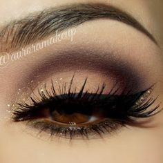 Cut Crease with Glitter. This blend of neutral hues with a touch of glitter really makes the eyes sparkle. Add winged eyeliner to dramatise the look.