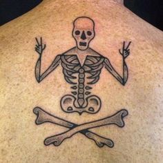 Hand poked happy skeleton tattoo on the upper back. Done at Into You Tattoo…