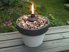 Table Tiki Torch Spray Paint+Terra Cotta Pot+River Pebbles+Tiki Torch Canister= Cheap & Pretty Table Torch