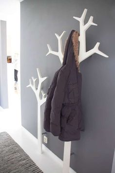 A Pretty Home in Norway | decor8 Clever idea for creating a coat rack that looks like a tree