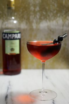 Boulevardier 1 part Campari 1 part Sweet Vermouth 1 part Bourbon Stir with ice, strain into a chilled cocktail coupe, and garnish with brandied cherries.