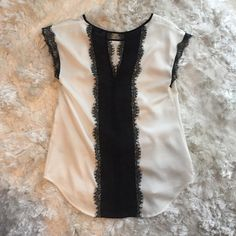 Express Work Top Silky, lacy, and beautiful Express top that is perfect for the work place or a night out! The lace detailing in the back is gorgeous! Express Tops Blouses