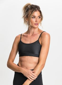 Ensure a perfect fit and comfort all day with the The Everyday Sport Bra. Featuring a thin strap classic design and breathable mesh lining, this sport bra is perfect on its own with tights, or layered with your favourite workout tank top.