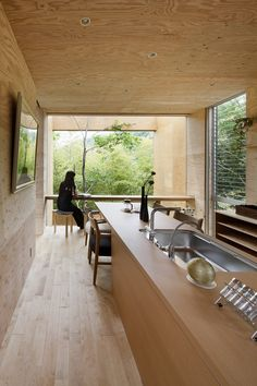 Image 10 of 14 from gallery of + node / UID Architects. Photograph by Hiroshi Ueda