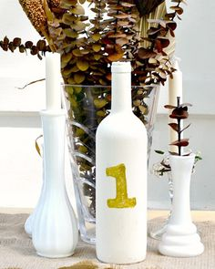 Forget fancy table numbers for your wedding or home. Make them yourself with this easy and cheap wine bottle craft! Diy Bottle, Wine Bottle Crafts, Diy Pendant Light, Fragrant Candles, Wine Bottle Candles, Diy Wedding, Diy And Crafts, Diy Projects, Table Numbers