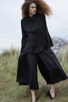 Cotton shirt with flared sleeves and hand beaded details. Styled with wide pleated culottes   #flaredsleeves #cottonshirt #blackshirt #fashionshoot #lookbook #culottes