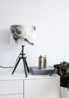 Acetone Art Table Lamp – Creating a mood with functional art Gold Lamp Shades, White Lamp Shade, Gold Spray Paint, Acetone, Lighting Store, Tripod Lamp, Simple Lines, Light Art, Lamp Bases
