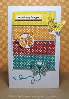 Love the rainbow strips and cut outs for the butterflies on this card